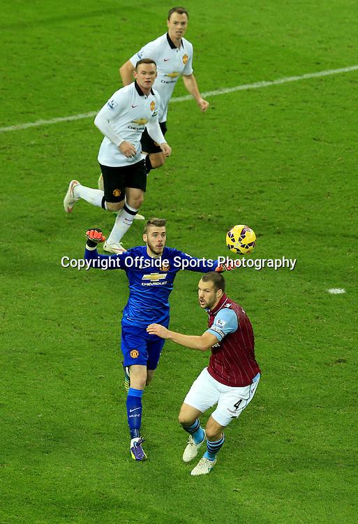20 December 2014 - Barclays Premier League - Aston Villa v Manchester United - Manchester United goalkeeper, David de Gea throws the ball over the head of Ron Vlaar of Aston Villa - Photo: Marc Atkins / Offside.