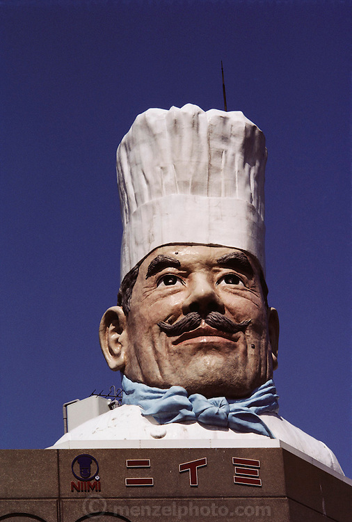 A giant chef head looms on top of a building in the Kappa-Bashi district of Tokyo, Japan, which is know as a restaurant equipment wholesale district, including plastic food.