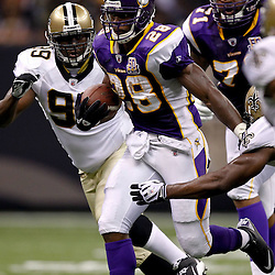 September 9, 2010; New Orleans, LA, USA;  Minnesota Vikings running back Adrian Peterson (28) is pursued by New Orleans Saints defenders during the NFL Kickoff season opener at the Louisiana Superdome. The New Orleans Saints defeated the Minnesota Vikings 14-9.  Mandatory Credit: Derick E. Hingle