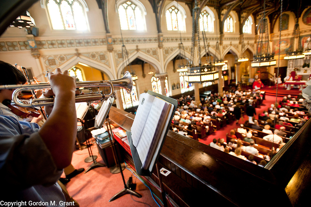 Oscar Mahoney, a member of the music ministry, plays the trumpet during a mass at Sacred Hearts of Jesus and Mary Church, dedicating it as a minor basilica, Long Island's first basilica, in Southampton. (May 27, 2012)