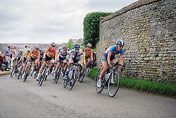 Peloton speed through the early kilometres at Aviva Women's Tour 2016 - Stage 5. A 113.2 km road race from Northampton to Kettering, UK on June 19th 2016.