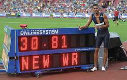 June 28, 2017 - Ostrava, Czech Republic - South African sprinter Wayde van Niekerk poses with his new world record in 300 metres displayed after the race during the Golden Spike Ostrava athletic meeting in Ostrava, Czech Republic, on June 28, 2017. (Credit Image: © Petr Sznapka/CTK via ZUMA Press)