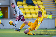 Alan Lithgow (#4) of Livingston FC attempts to block the cross of Callumn Morrison (#38) of Heart of Midlothian FC during the Ladbrokes Scottish Premiership match between Livingston FC and Heart of Midlothian at the Tony Macaroni Arena, Livingston, Scotland on 26 October 2019.