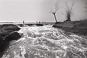 Gabura,Satkhera February,2010- Villagers cross collapsed embankment -Copy Right-Monirul Alam