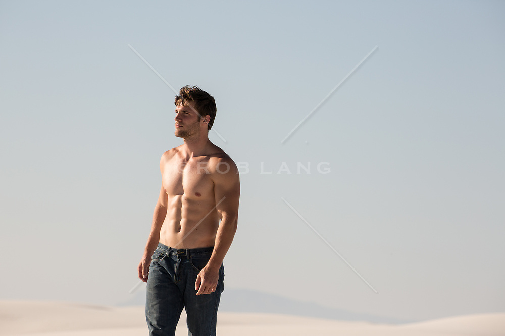 shirtless muscular man in the desert