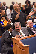 North Charleston Police Chief Eddie Driggers and Assistant Police Chief Reggie Burgess (left) listen to Rev. Al Sharpton addresses a healing service at Charity Missionary Baptist Church April 12, 2015 in North Charleston, South Carolina. Sharpton spoke following the recent fatal shooting of unarmed motorist Walter Scott police and thanked the Mayor and Police Chief for doing the right thing in charging the officer with murder.