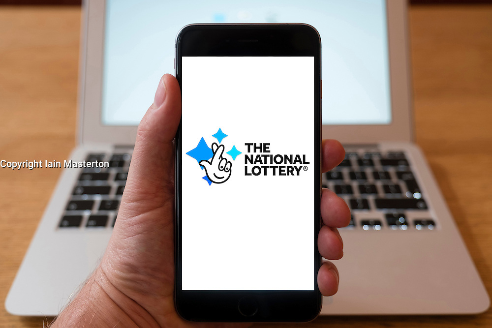 Using iPhone smartphone to display logo of The National Lottery