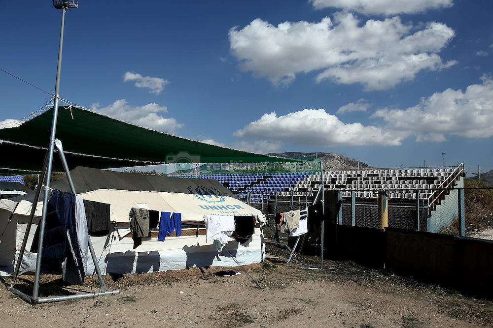 October 5, 2016 - Athens, Greece - UNHCR tents set in a sports facility at Helliniko Olympic complex inAthens, Greece on October 5, 2016.Almost 2,500 migrants and refugees, mainly Afghani, are housed at the former Athens airport site, and to an olympic complex used in the 2004 Olympics. In total 60.736 refugees and other migrants are stranded in Greece. (Credit Image: © Panayiotis Tzamaros/NurPhoto via ZUMA Press)