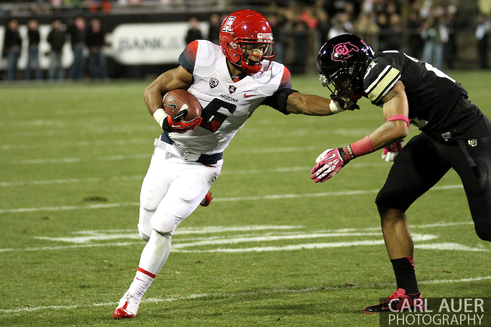 October 26th, 2013:  University of Arizona Wildcats freshman wide receiver Nate Phillips (6) attempts to stiff arm his way to a first down in the first quarter of the NCAA football game between the University of Arizona Wildcats and the University of Colorado Buffaloes at Folsom Field in Boulder, Colorado