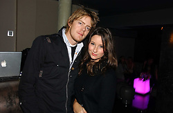 Actor KRIS MARSHALL and KELLY EASTWOOD at a party to celebrate the opening of Kitts nightclub, 7-12 Sloane Square, London on 7th December 2006.<br />
