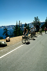 Oregon: Crater Lake National Park.  Bicycling at the lake.  Model released.  Photo: orcrat105.  Photo copyright Lee Foster, www.fostertravel.com, (510) 549-2202, lee@fostertravel.com