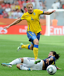 28.06.2011, BayArena, Leverkusen, GER, FIFA Women Worldcup 2011, Gruppe C, Kolumbien (COL) vs. Schweden (SWE), im Bild Annica SVENSSON ( #4 SWE ) ueberspringt Yoreli RINCON ( #10 COL )..// during the FIFA Women¥s Worldcup 2011, Pool C, Colombia vs. Sweden on 2011/06/28, BayArena, Leverkusen, Germany.       ****** out of GER / CRO  / BEL ******