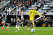 Burton Albion midfielder Lasse Vigen Christensen (24) is tackled by Newcastle United defender Chancel Mbemba (18) during the EFL Sky Bet Championship match between Newcastle United and Burton Albion at St. James's Park, Newcastle, England on 5 April 2017. Photo by Richard Holmes.