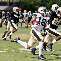 Aug 3, 2013; Metairie, LA, USA; New Orleans Saints wide receiver Saalim Hakim (18) is pursued by cornerback A.J. Davis (20) returning a kickoff during a scrimmage at the team training facility. Mandatory Credit: Derick E. Hingle-USA TODAY Sports