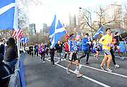 James Lu, 76, of Brooklyn, carries the Scottish flag as he participates in the 12th annual Scotland Run in New York's Central Park to celebrate Scotland Week festivities, Saturday, April 4, 2015.  (Photo by Diane Bondareff/Invision for Scottish Government/AP Images)