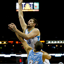 Mar 25, 2013; New Orleans, LA, USA; New Orleans Hornets power forward Ryan Anderson (33) shoots over Denver Nuggets point guard Andre Miller (24) during the second quarter of a game at the New Orleans Arena. Mandatory Credit: Derick E. Hingle-USA TODAY Sports