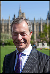 UKIP party leader Nigel Farage poses for the media in front of the Houses of Parliament in Westminster, central London following his party's success in the elections in England, London, UK, 03 May, 2013. Daniel Leal-Olivas / I-images.