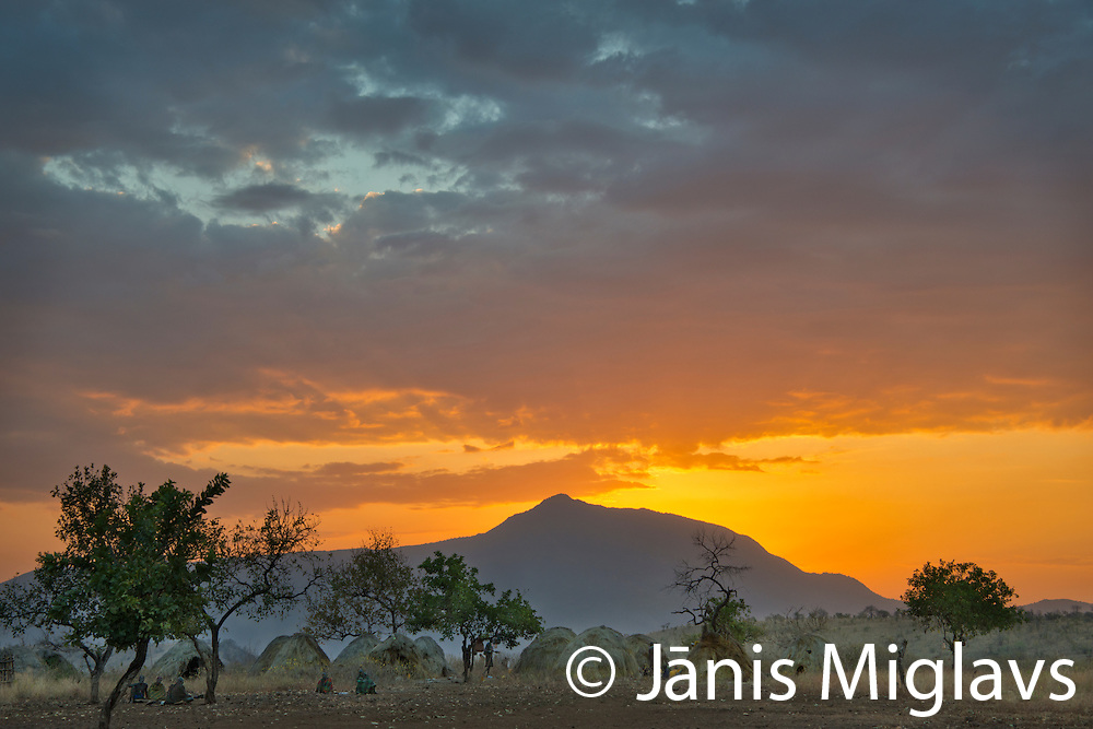 Sunrise over Belle, a Mursi tribe village in front of mountain in Mago National Park, Omo Valley, Ethiopia, Africa.