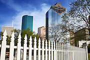 Image of downtown buildings and a white fence in Houston, Texas, American South
