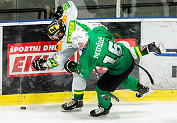 David Slivnik of Lustenau and Ales Music of SZ Olimpija during Ice Hockey match between HK SZ Olimpija and EHC Alge Elastic Lustenau in Semifinal of Alps Hockey League 2018/19, on April 1, 2019, in Arena Tivoli, Ljubljana, Slovenia. Photo by Vid Ponikvar / Sportida