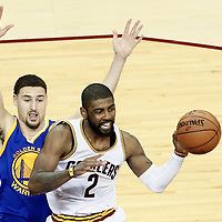 10 June 2016: Cleveland Cavaliers guard Kyrie Irving (2) passes the ball past Golden State Warriors guard Klay Thompson (11) during the Golden State Warriors 108-97 victory over the Cleveland Cavaliers, during Game Four of the 2016 NBA Finals at the Quicken Loans Arena, Cleveland, Ohio, USA.