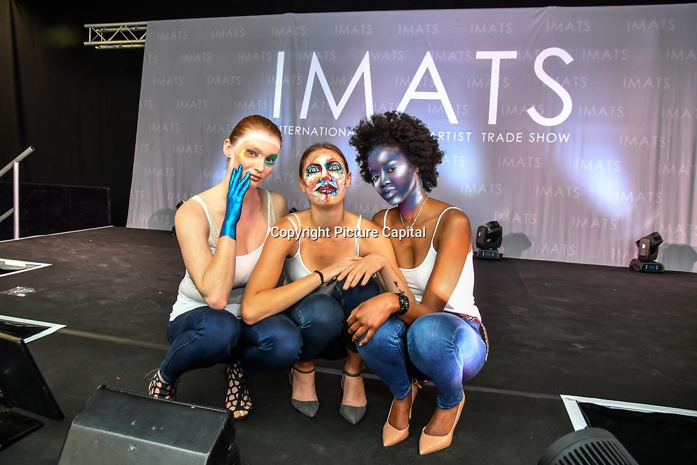 Purple look - Paul Merchant - Kryolan gobal head of makeup - Sketch look - kryolan head of education Gemma Horner - Theatrical look Leanne Simms Kryolan International Educator  demo at IMATS on 18 May 2019,  London, UK.