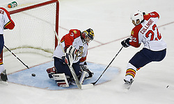 Feb 28, 2009; Newark, NJ, USA; New Jersey Devils left wing Zach Parise's (9) shot slips through the pads of Florida Panthers goalie Craig Anderson (31) during the first period at the Prudential Center.