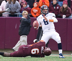 Virginia Tech defensive end Jason Worilds (6) forces Virginia quarterback Marc Verica (6) to throw on 3rd down in the last series of the game.  The Virginia Tech Hokies defeated the Virginia Cavaliers 17-14 in NCAA football at Lane Stadium on the campus of Virginia Tech in Blacksburg, VA on November 29, 2008.