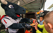 Houston Texans mascot Toro helps serve breakfast at Montgomery Elementary School, March 8, 2016.