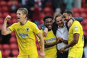 AFC Wimbledon defender Paul Robinson (6) leads the celebrations with AFC Wimbledon manager Neal Ardley, AFC Wimbledon striker Dominic Poleon (10), AFC Wimbledon striker Tyrone Barnett (23) during the EFL Sky Bet League 1 match between Charlton Athletic and AFC Wimbledon at The Valley, London, England on 17 September 2016. Photo by Stuart Butcher.