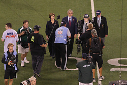 Sept 11, 2011; East Rutherford, NJ, USA;  Former President George Bush and First Lady Laura Bush walk onto the field for the coin toss before the first half at the MetLife Stadium.