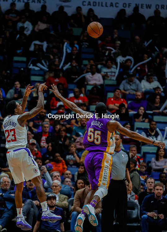 Jan 28, 2018; New Orleans, LA, USA; LA Clippers guard Lou Williams (23) shoots over New Orleans Pelicans guard E'Twaun Moore (55) during the third quarter at the Smoothie King Center. The Clippers defeated the Pelicans 112-103. Mandatory Credit: Derick E. Hingle-USA TODAY Sports
