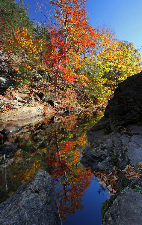 Glorious fall foliage photography reflection of this beautiful New England fall foliage scenery in Connecticut near East Haddam and at the bottom of Chapman warefall. Connecticut photography pictures are available as museum quality photography prints, canvas prints, acrylic prints or metal prints. Prints may be framed and matted to the individual liking and decorating needs:<br />