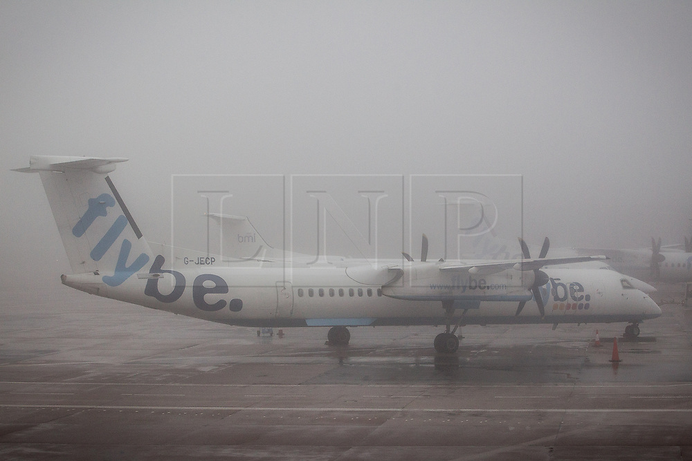 © Licensed to London News Pictures . 09/01/2013 . Manchester , UK . Planes sit on the ground in thick fog . Thick fog is causing flight delays and cancellations in the North of England today (9th January 2013) . Photo credit : Joel Goodman/LNP