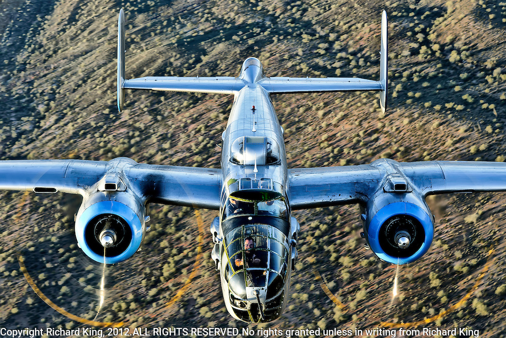 Close-up air-to-air color photograph of B-25 Mitchell Bomber flying over the Arizona