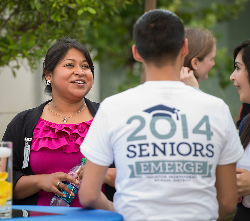 Students in the EMERGE program celebrate their first graduating class during a ceremony at Carnegie Vanguard High School, April 22, 2014.