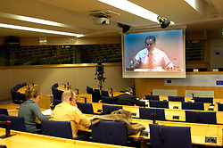 BRUSSELS, BELGIUM - DEC-20-2005 - Journalists in the European Paliament press room watch as Tony Blair , Prime Minister of Great Britain addresses members of the European Parliament about the accomplishments of the British European Council Presidency and the EU budget that was negotiated during the recent European Summit in Brussels. (PHOTO © JOCK FISTICK)