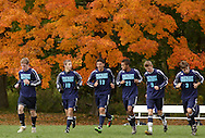 Beacon, New York - John Jay East Fishkill soccer players jog on the field to warm up before playing Beacon in a high school boys' soccer game on Oct. 16, 2010. ©Tom Bushey / The Image Works