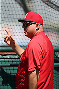 ANAHEIM, CA - APRIL 30:  Manager Mike Scioscia #14 of the Los Angeles Angels of Anaheim makes a point as he chats on the field during batting practice before the game against the Cleveland Indians at Angel Stadium on Wednesday, April 30, 2014 in Anaheim, California. The Angels won the game 7-1. (Photo by Paul Spinelli/MLB Photos via Getty Images) *** Local Caption *** Mike Scioscia