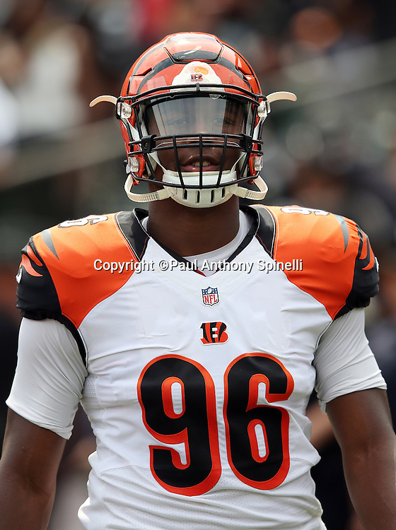 Cincinnati Bengals defensive end Carlos Dunlap (96) looks on from the sideline during the 2015 NFL week 1 regular season football game against the Oakland Raiders on Sunday, Sept. 13, 2015 in Oakland, Calif. The Bengals won the game 33-13. (©Paul Anthony Spinelli)