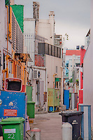 Backstreet alleyway in Singapore  - clean but relatively untidy.