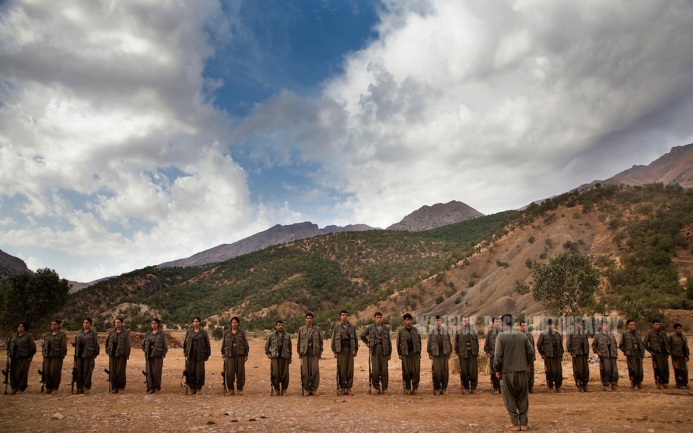 QANDIL MOUNTAINS, IRAQI KURDISTAN - SEPTEMBER 19: PKK (Kurdish Worker's Party) soldiers stand at attention during training exercises, on September 19, 2010, in the Qandil Mountains, Iraqi Kurdistan. Labelled as terrorists by the Turkish, US and EU, it's in the Qandil Mountains near the border where the guerrillas of the PKK live and wage their 26 year war against Turkey that has claimed over 40,000 lives. (Photo by Warrick Page)