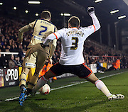 Konstantinos Stafylidis tackle that got him sent off during the Sky Bet Championship match between Fulham and Leeds United at Craven Cottage, London, England on 18 March 2015. Photo by Matthew Redman.