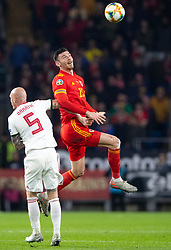 CARDIFF, WALES - Tuesday, November 19, 2019: Wales' Kieffer Moore challenges for a header with Hungary's Botond Baráth during the final UEFA Euro 2020 Qualifying Group E match between Wales and Hungary at the Cardiff City Stadium. (Pic by Laura Malkin/Propaganda)