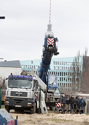 Crane during the removal of a section of the East Side Gallery, the Berlin Wall. Some 25 meters of this section of the wall that mostly came down 23 years ago and marked the end of the cold war are taken away to make way for a new housing development on river Spree, a project called Living Levels, Berlin, Germany,  March 1, 2013. Photo by Imago / i-Images...UK ONLY