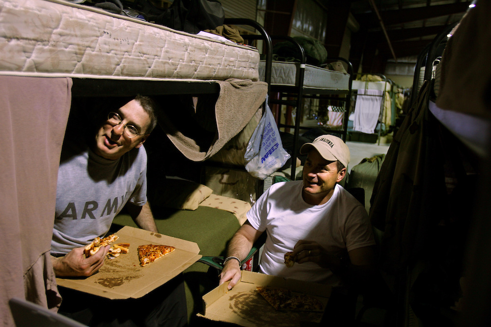 Left to right, Staff Sgt. Ron Morris and Sgt. Kevin Avery, from the 724th Transportation Company, rest after deployment in Iraq, before going back to the United States, Kuwait, Feb. 7, 2005. A member of their unit, Army Spc. Keith Matt Maupin, was taken hostage. He is the only US soldier that is listed MIA from this war.