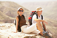 Hiking couple sitting on  mountain