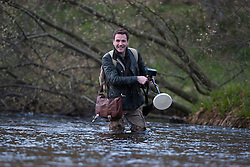 Historian Ashley Cowie in a river near Fort William, during his road trip. He is doing a seven part series for The Scottish Sun on Scotland's treasure hunts at the end of April..©Michael Schofield..