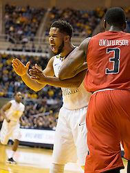West Virginia Mountaineers guard Gary Browne (14) celebrates after a made basket against the Texas Tech Red Raiders during the first half at the WVU Coliseum.