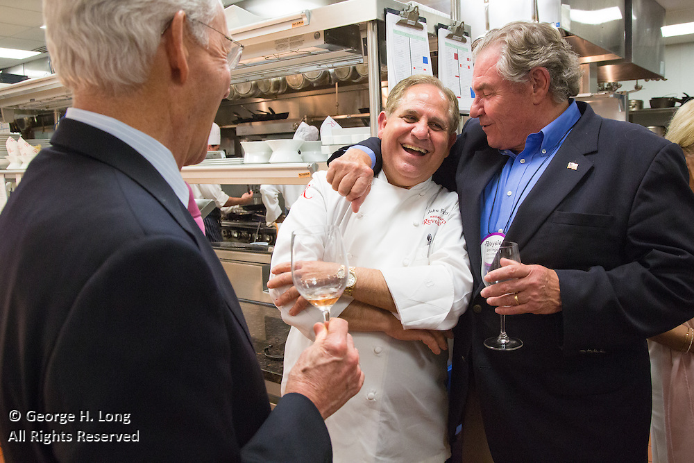 Chef John Folse gets a hug from Boysie Bollinger in the kitchen at his Restaurant R'evolution